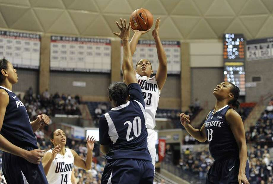 Connecticut's Kaleena Mosqueda-Lewis shoots over Penn State's Alex Bentley (20) during the second half of an NCAA college basketball game in Storrs, Conn., Thursday, Dec. 6, 2012. Mosqueda-Lewis was top scorer with 25 total points. Connecticut won 67-52. (AP Photo/Jessica Hill) Photo: AP / FR125654 AP