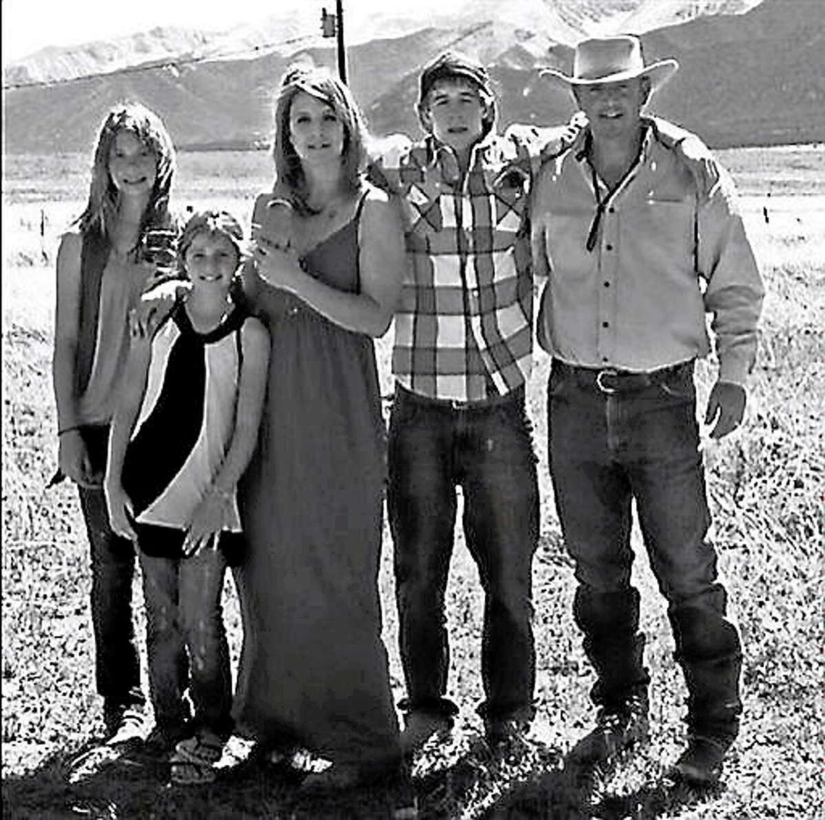 This 2012 photo provided by the Johnson family shows Dawna Johnson, 45, third left, and Dwayne Johnson, 46, right, with their children, from left, Kiowa-Rain Johnson, 18, Gracie Johnson, 13, and Dakota Johnson, in front of Mount Princeton in Colorado. Dwayne, Dawna and Kiowa-Rain Johnson were killed in Monday?s Sept. 30, 2013, rockslide near Buena Vista, Colo. Gracie Johnson was rescued from the rubble and hospitalized in Denver. Also killed were Baigen Walker, 10, and Paris Walkup, 22, both of Birch Tree, Mo. They were nephews of Dwayne and Dawna Johnson. (AP Photo/Johnson Family)