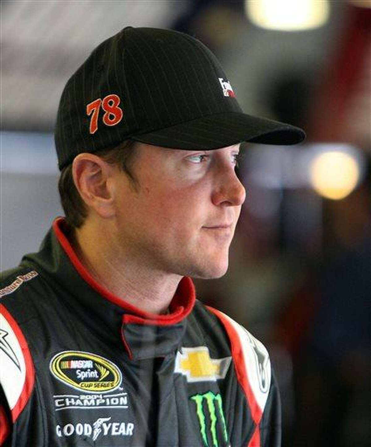 Kurt Busch gets ready for the final practice before Sunday's NASCAR Sprint Cup auto race at New Hampshire Motor Speedway, Saturday, July 13, 2013 in Loudon, N.H. (AP Photo/Jim Cole)