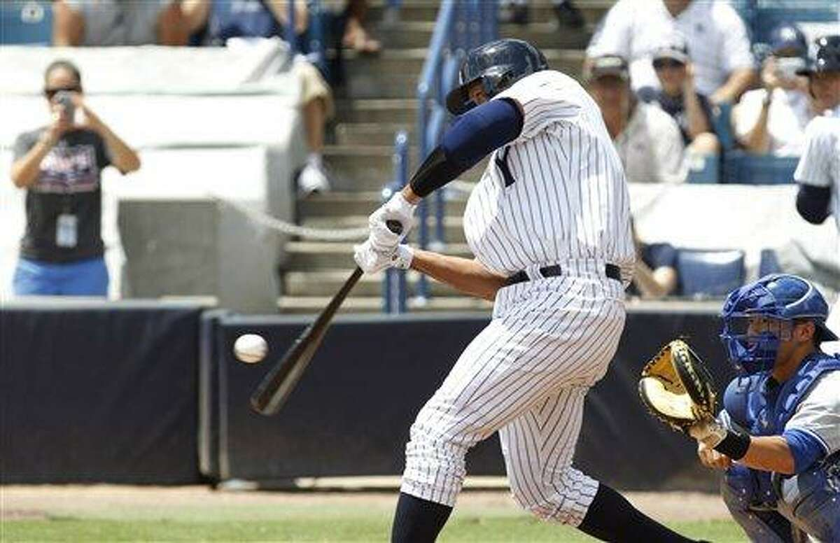 New York Yankees' Alex Rodriquez bats for the Tampa Yankees against the Dunedin Blue Jays in a minor league baseball rehab game in Tampa, Fla., Wednesday, July 10, 2013. (AP Photo/Scott Iskowitz)