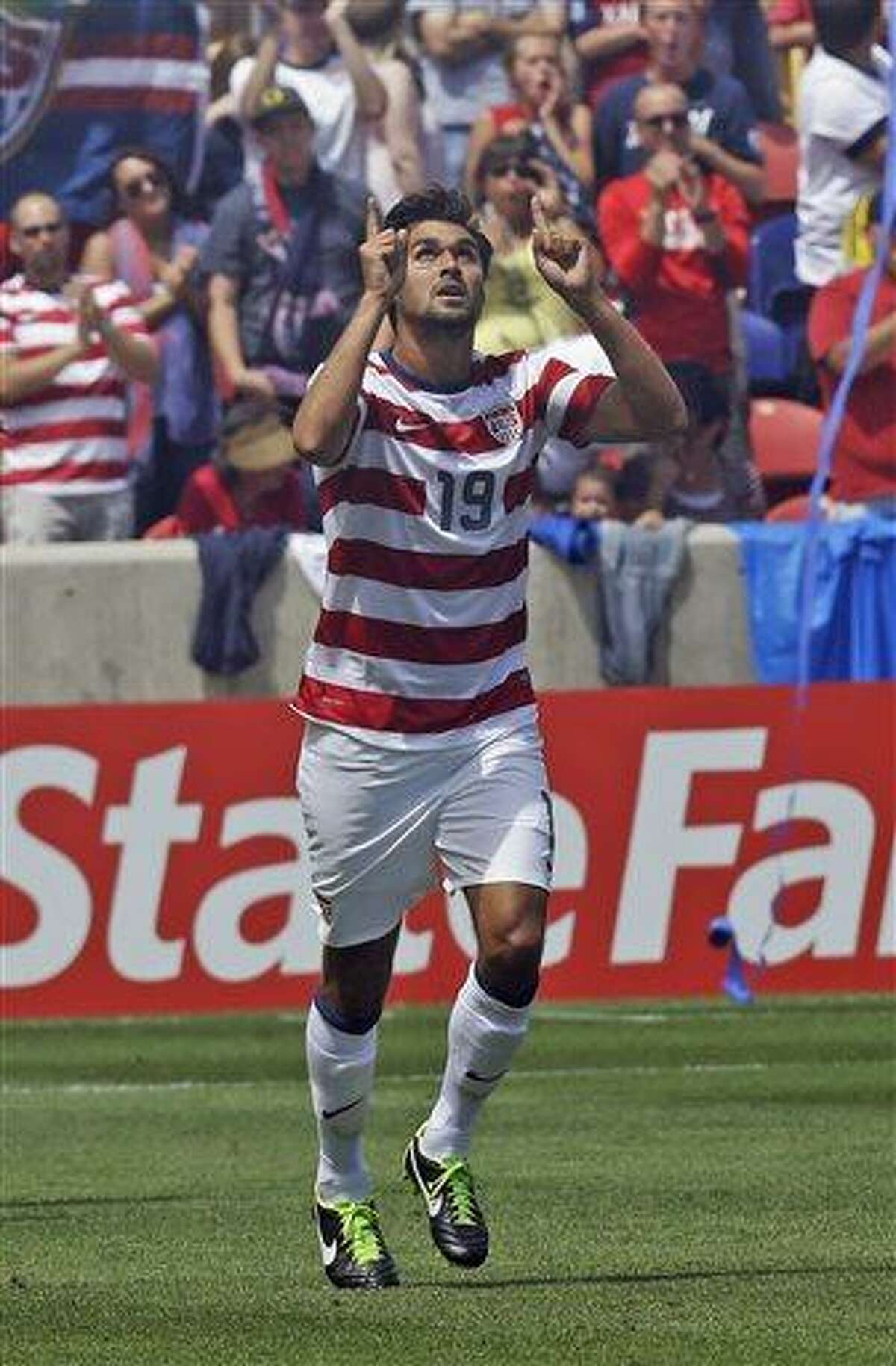United States' Chris Wondolowski (19) celebrates after scoring against Cuba during the second half of a CONCACAF Gold Cup soccer game on Saturday, July 13, 2013, in Sandy, Utah. United States defeated Cuba 4-1. (AP Photo/Rick Bowmer)