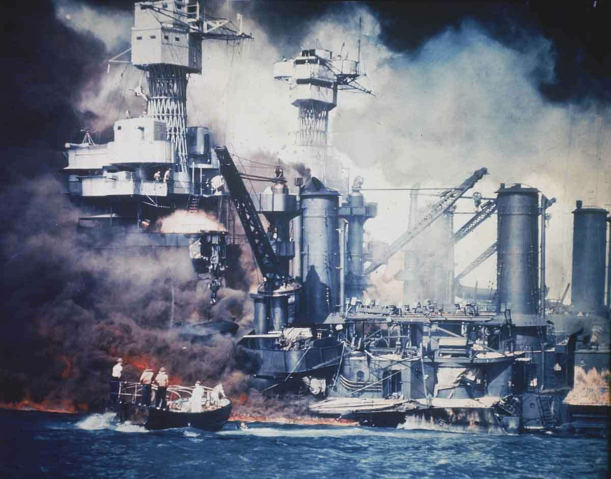 *** FILE *** A small boat rescues a USS West Virginia crew member from the water after the Japanese bombing of Pearl Harbor, Hawaii on Dec. 7, 1941 during World War II. Two men can be seen on the superstructure, upper center. The mast of the USS Tennessee is beyond the burning West Virginia. On Dec. 7, 1941, Japanese Imperial Navy navigator Maeda guided his Kate bomber to Pearl Harbor and fired a torpedo that helped sink the USS West Virginia. This week,(Dec. 3, 2006) Takeshi Maeda and John Rauschkolb a crewman aboard the West Virginia at the time of the attack. met face-to-face for the first time _ and shook hands. (AP Photo)