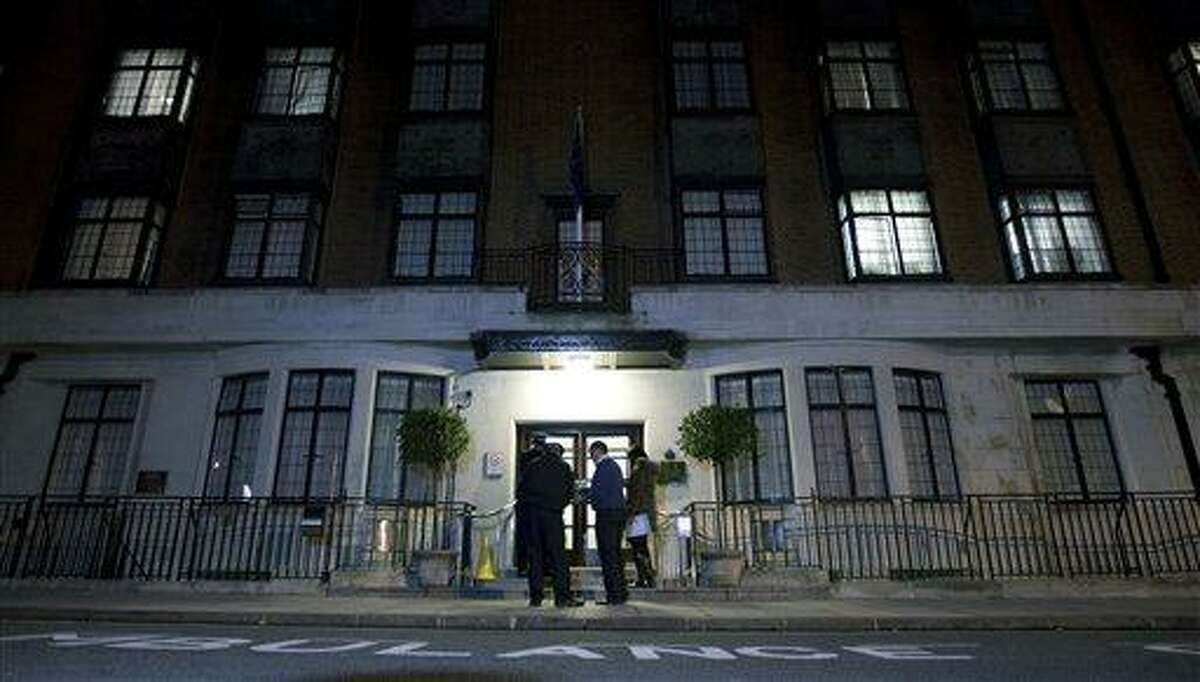 In this Dec. 3 file photo, policeman stand guard outside the King Edward VII hospital in London where the Duchess of Cambridge had been admitted with a severe form of morning sickness. King Edward VII hospital says the nurse involved in Kate hoax call has died Friday. (AP Photo/Alastair Grant, File)