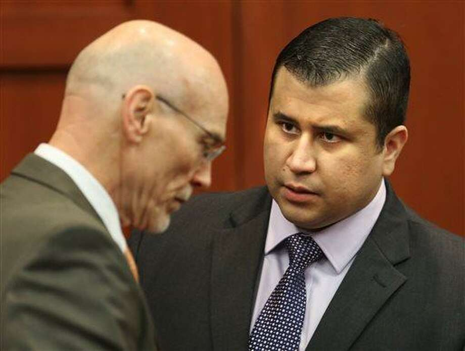 George Zimmerman, right, speaks with defense counsel Don West after the jury leaves the courtroom for more deliberations, in the 25th day of his  trial at the Seminole County Criminal Justice Center, in Sanford, Fla., Saturday, July 13, 2013. Zimmerman has been charged in the 2012 shooting death of Trayvon Martin. (AP Photo/Orlando Sentinel, Joe Burbank, Pool) Photo: AP / Pool Orlando Sentinel