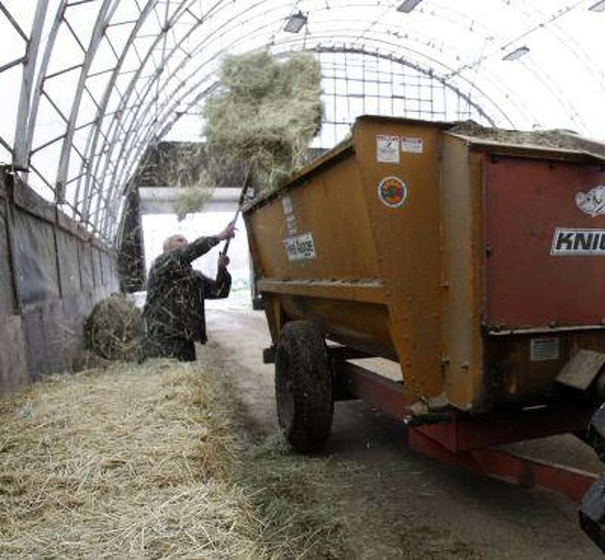 FILE - This Oct. 16, 2012, file photo shows farmer Myles Goodrich loading a feed wagon at his farm in Danville, Vt. House Republicans strip food stamps from the farm bill in an attempt to get the legislation passed after an embarrassing defeat last month. White House has threatened a veto and Democrats are crying foul. bill had traditionally paired two programs to get bipartisan support but conservatives said original bill did not cut food stamps deep enough. Timing of House vote unclear. (AP Photo/Toby Talbot, File)