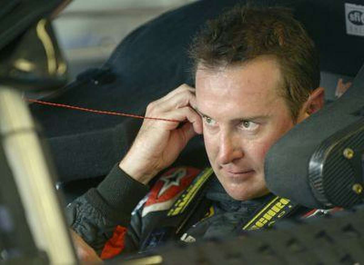 Kurt Busch adjusts his earplugs as he prepares to drive in a practice session for the NASCAR Sprint Cup auto race at Daytona International Speedway, Thursday, July 4, 2013, in Daytona Beach, Fla.