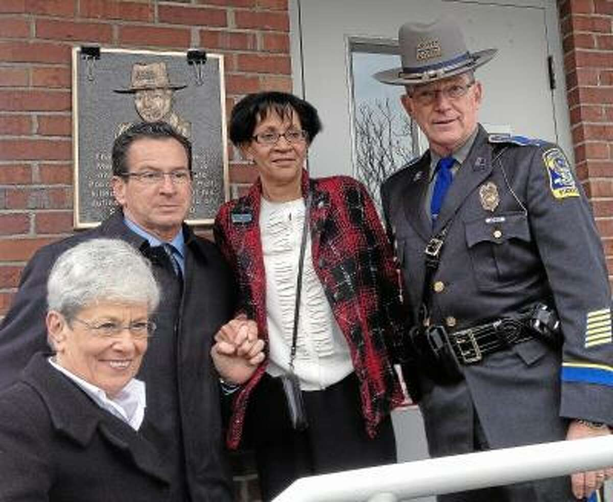 State Trooper First Class Kenneth Hall, a 22-year veteran who was killed in the line of duty was honored on Friday at a ceremony dedicating the Memorial Scale House at the weigh station on Route 91 North in Middletown. Sheila Hall, widow of TFC Hall, Governor Dannel Malloy and Lt. Governor Nancy Wyman. Lauren Sievert/The Middletown Press