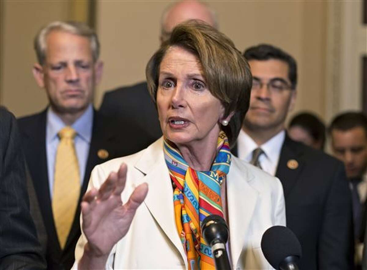 House Minority Leader Nancy Pelosi, D-Calif., center, and House Democratic leaders speak to reporters just before midnight Monday. For the first time in nearly two decades, the federal government staggered into a partial shutdown after congressional Republicans demanded changes in the nation's health care.