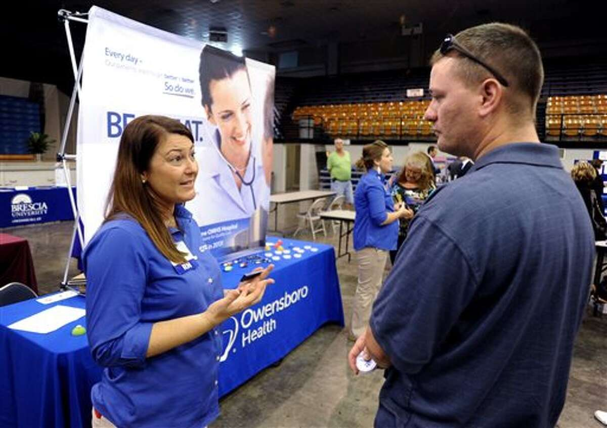 In this Tuesday, Oct. 1, 2013, photo, registered nurse Salanda Bowman, left, talks with part-time Kentucky Wesleyan College student, Jason Ward, of Whitesville, about job openings at the Owensboro Health Regional Hospital during a Regional Career and Job Fair in the Owensboro Sports Center in Owensboro, Ky. Payroll processor ADP reports on job growth for September on Wednesday, Oct. 2, 2013. (Gary Emord-Netzley/AP/The Messenger-Inquirer)
