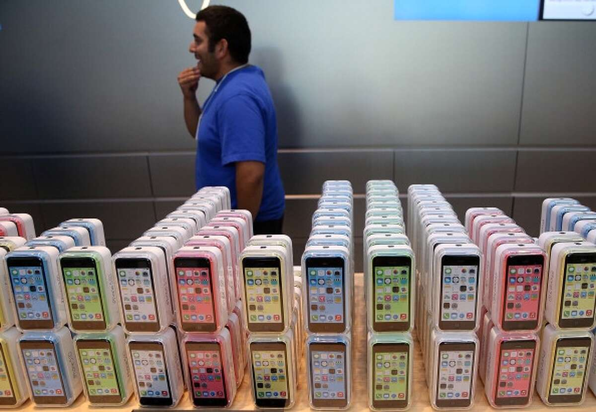 The new Apple iPhone 5C is displayed at an Apple Store on September 20, 2013 in Palo Alto, California. Apple launched two new models of iPhone: the iPhone 5S, which is preceded by the iPhone 5, and a cheaper, paired down version, the iPhone 5C. The phones come with a new operating system. (Photo by Justin Sullivan/Getty Images)