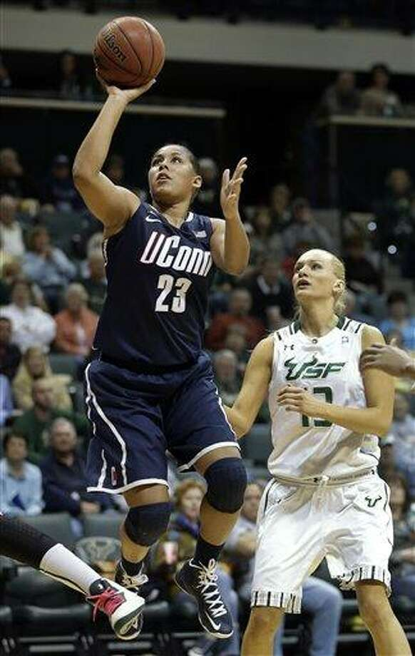 Connecticut forward Kaleena Mosqueda-Lewis (23) shoots past South Florida guard Inga Orekhova (13) during the second half of an NCAA college basketball game Saturday, March 2, 2013, in Tampa, Fla.  Mosqueda-Lewis had 32 points in UConn's 85-51 win. (AP Photo/Chris O'Meara) Photo: ASSOCIATED PRESS / AP2013
