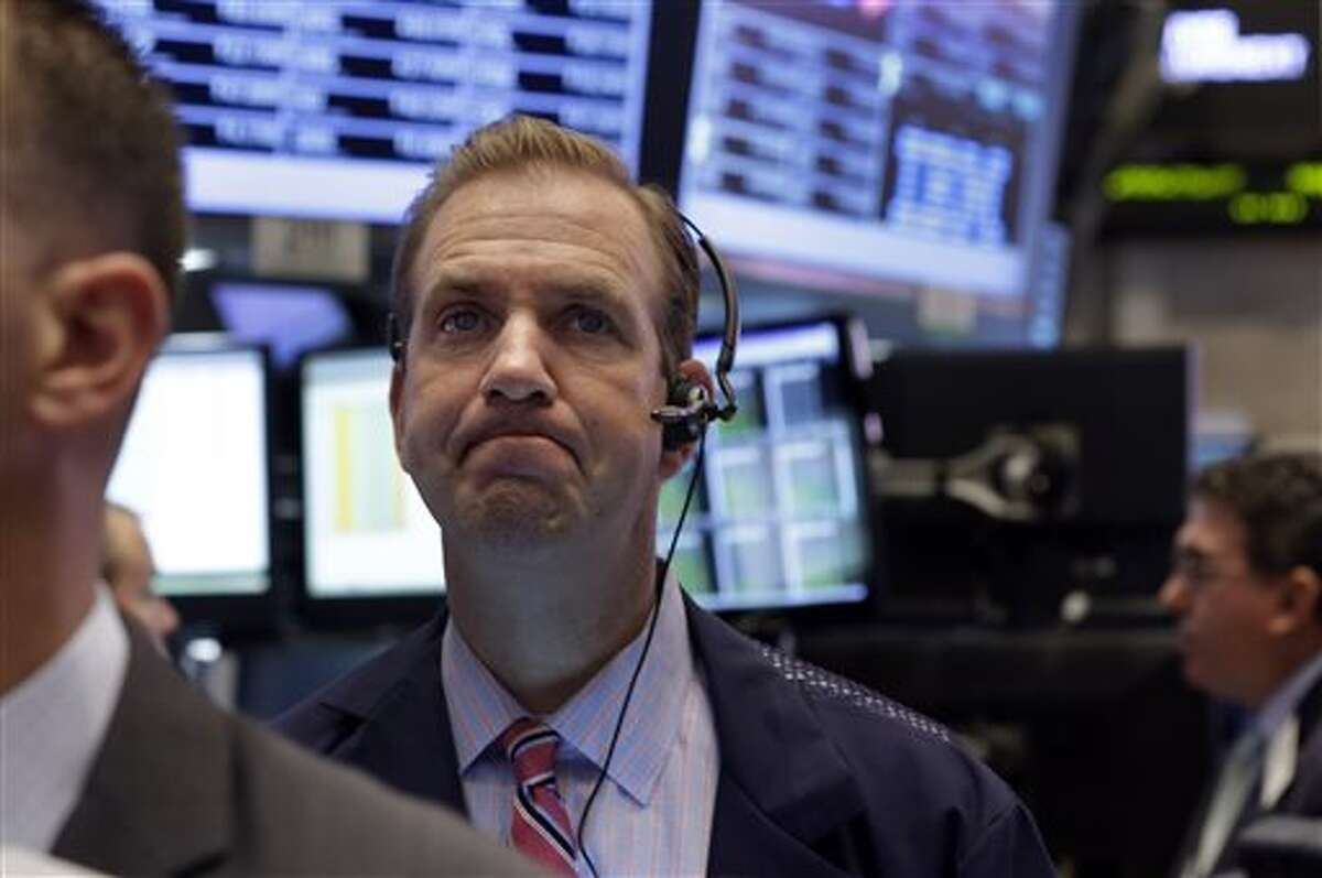 In this Sept. 18, file photo, Trader Michael Smyth works on the floor of the New York Stock Exchange.