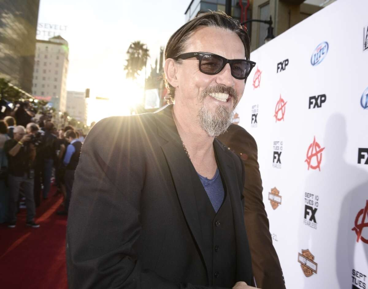 """Actor Tommy Flanagan arrives on the red carpet at the season six premiere screening of the television series """"Sons of Anarchy"""" at the Dolby Theatre on Saturday, Sept. 7, 2013 in Los Angeles."""