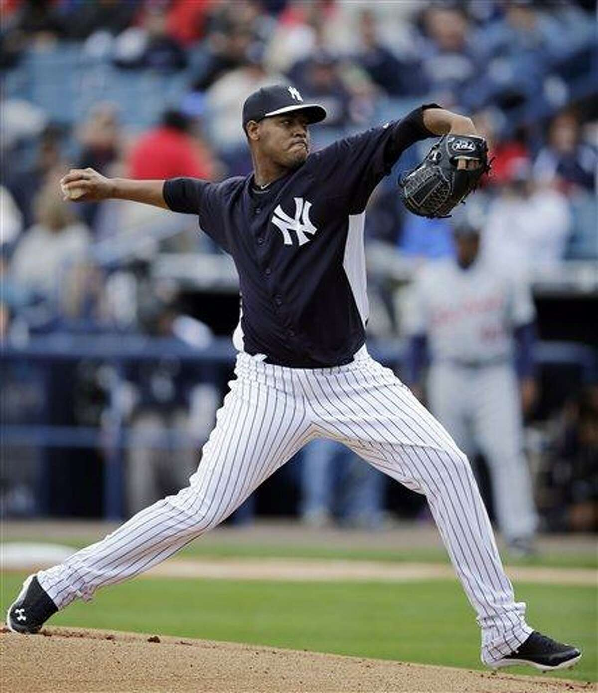 New York Yankees' Ivan Nova pitches during the first inning of an exhibition spring training baseball game against the Detroit Tigers, Saturday, March 2, 2013, in Tampa, Fla. (AP Photo/Matt Slocum)
