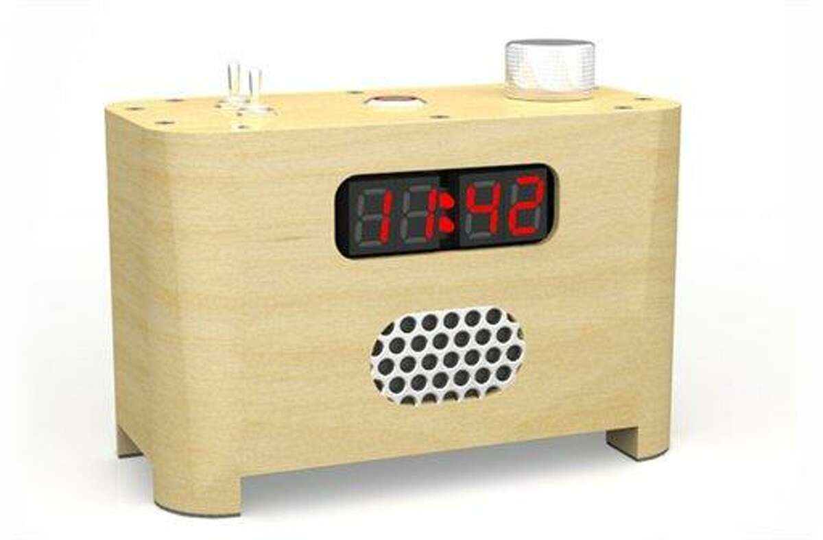 An undated photo provided by Sammut Tech, LLC, shows the LED Ramos alarm clock. Inventor Paul Sammut designed the clock that forces its owner to get out of bed after he found it hard to get out of bed after college. Once the alarm goes off, to stop it one must get out of bed, go into the kitchen or bathroom, and punch the day's date into a telephone-style keypad. Associated Press