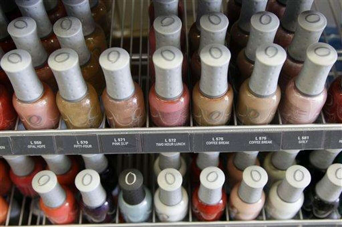 Nail care products are displayed at a beauty supply shop in San Francisco Monday. California's chemical regulators randomly sampled dozens of professional grade nail polishes that claimed to be free of a