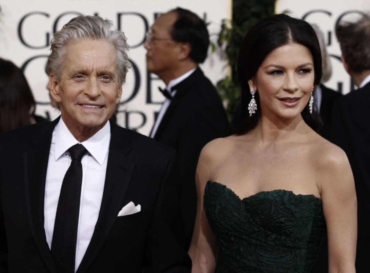Michael Douglas arrives with his wife Catherine Zeta-Jones for the Golden Globe Awards Sunday, Jan. 16, 2011, in Beverly Hills, Calif.