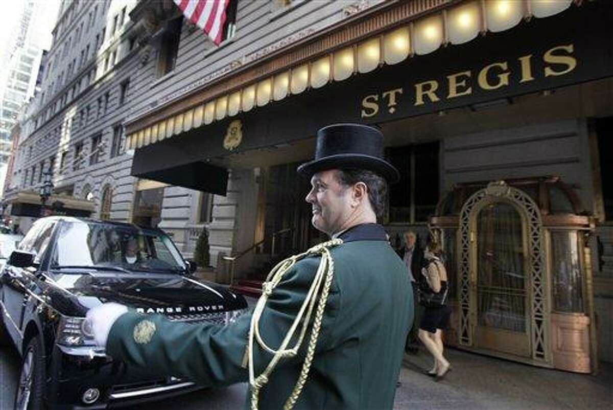 Head doorman Jim Sheehy works outside New York's St. Regis Hotel on March 14. A century after the Titanic sank, the legacy of the ship's wealthiest and most famous passenger, John Jacob Astor, quietly lives on at the luxury hotel he built in New York City. Associated Press