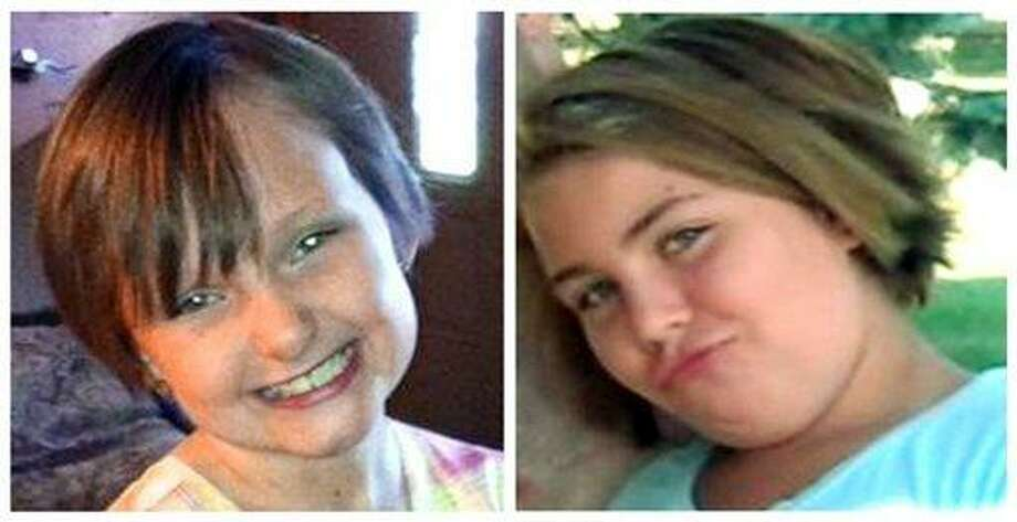 This combo made from undated photos provided by the FBI shows cousins Lyric Cook, 10, right, and Elizabeth Collins, 8, who have been missing since Friday, July 13, 2012. Authorities say hunters have found bodies believed to be two young Iowa cousins who disappeared while riding their bikes in July. (AP Photo/FBI) Photo: AP / Federal Bureau of Investigation