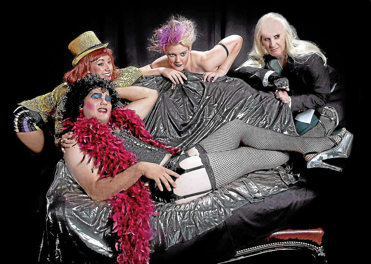 Submitted photo - Phoenix Theater CompanyMichael Gonsalves of Ellington as Frank N Furter, center, is joined by cast members Em Mazotas of Middletown as Magenta, John Demetre of East Haven as Riff Raff, Eden Beaudoian of New Britain as Columbia.