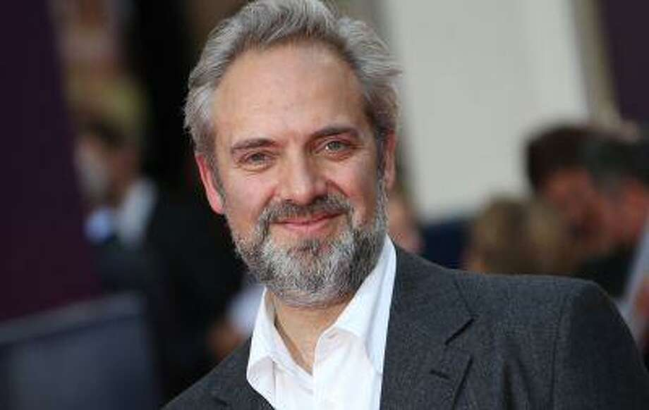 Director Sam Mendes arrives for the opening night of Charlie and the Chocolate Factory, a new stage musical based on Roald Dahl's popular story about Willy Wonka and his amazing Chocolate Factory, at the Drury Lane Theatre in central London, Tuesday, June 25, 2013. (Photo by Joel Ryan/Invision/AP) Photo: Joel Ryan/Invision/AP / AP2013