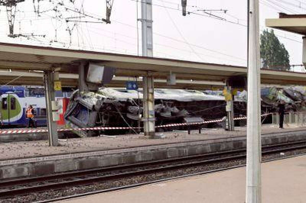 A picture shows a derailed wagon on the site of a train accident in the railway station of Bretigny-sur-Orge on July 12 near Paris. A train derailed in the Paris suburb of Bretigny-sur-Orge in an accident that caused 'many casualties', authorities said.