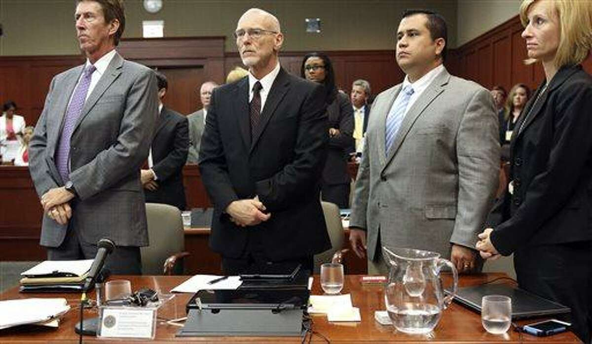 George Zimmerman, second from right, stands with his defense team Mark O'Mara, left, Don West, second from left, and Lorna Truett, right, during his trial in Seminole circuit court in Sanford, Fla. Thursday, July 11, 2013. Zimmerman has been charged with second-degree murder for the 2012 shooting death of Trayvon Martin. (AP Photo/Orlando Sentinel, Gary W. Green, Pool)