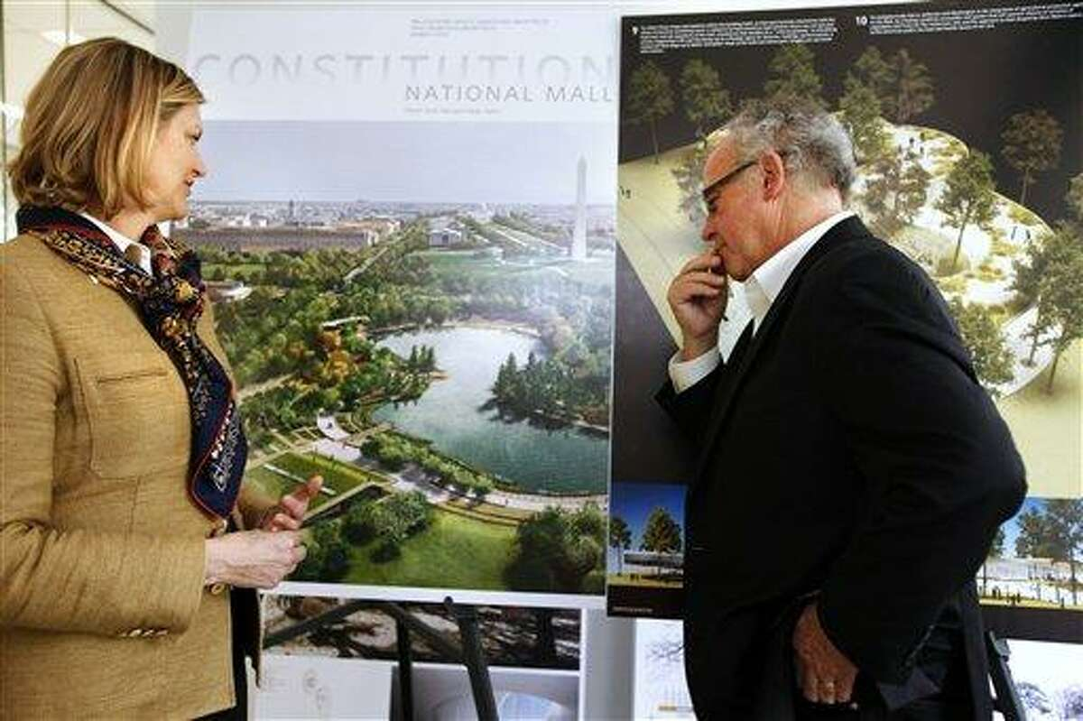 Caroline Cunningham, President of the Trust for the National Mall, left, and Donald Stastny, an architect advising the trust, look at two of several proposed designs April 5 for overused and neglected areas of the National Mall in Washington. Associated Press