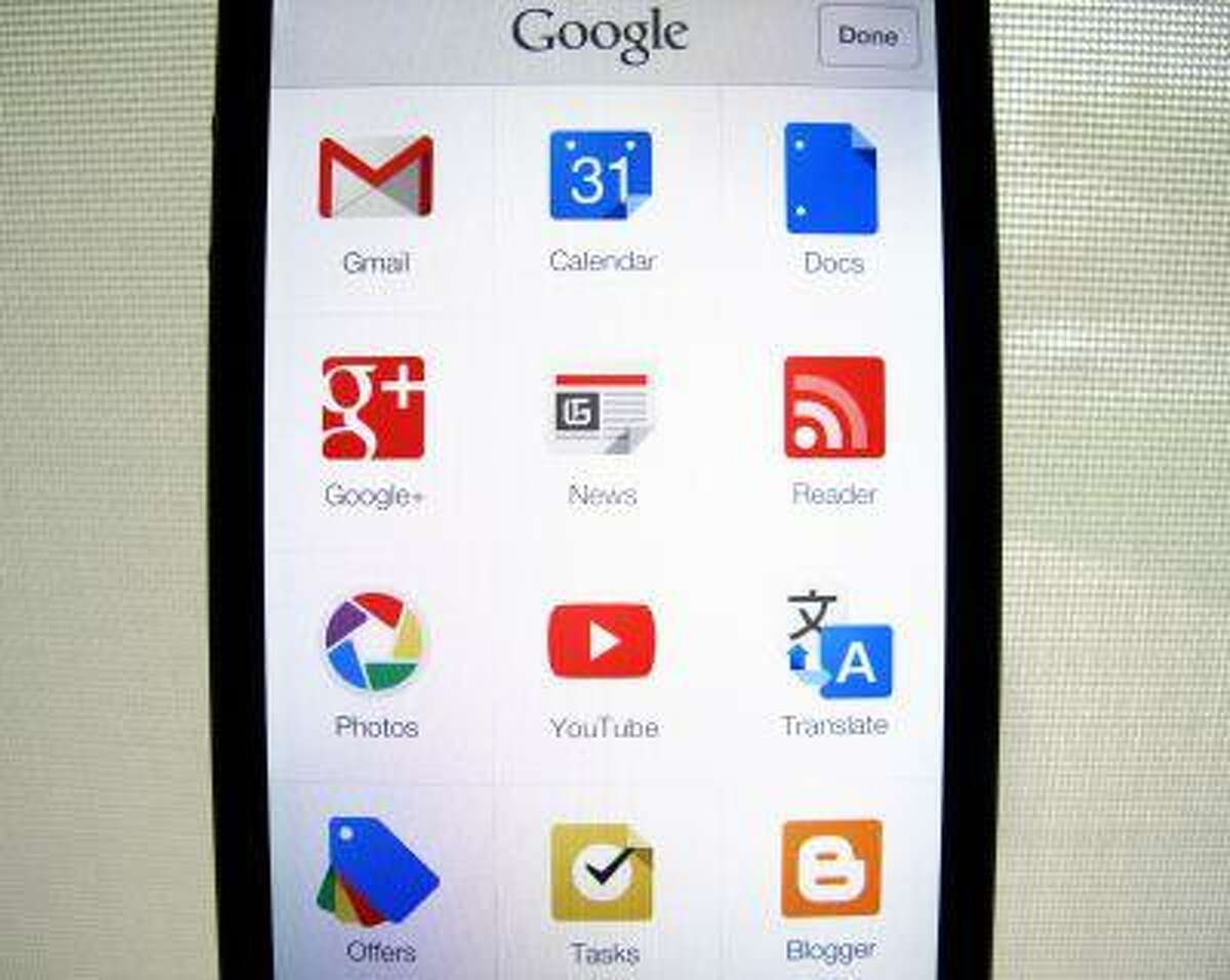 Google apps are shown on an Apple iphone 5 in this photo illustration in Encinitas, California, April 16, 2013.