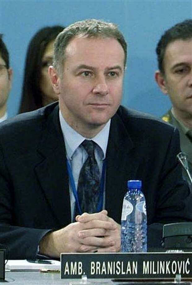 In this photo made available by NATO, in this Dec. 14, 2006 file photo, Serbia's Ambassador to NATO Branislav Milinkovic is seen during a meeting at NATO headquarters in Brussels, Belgium. A Serbian government statement said Wednesday Dec. 5, 2012,  that 52-year old Milinkovic committed suicide by leaping from a busy parking garage platform at Brussels Airport on Tuesday night.  A diplomat who could not be identified because he was not authorized to speak to the media said Milinkovic suddenly jumped from the 8- to 10-meter-high (26- to 33-foot-high) platform while waiting with the Serbian delegation for foreign ministry officials due to hold talks with NATO officials. (AP Photo/NATO, file) Photo: AP / NATO
