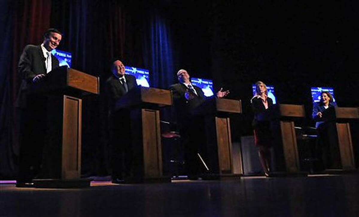 From left, Democratic Senate candidates U.S. Rep. Chris Murphy, state Rep. William Tong, Matthew Oakes, Lee Whitnum, and former Secretary of the State Susan Bysiewicz, share a laugh during a debate in Storrs, Conn. AP Photo/The Hartford Courant, John Woike, Pool