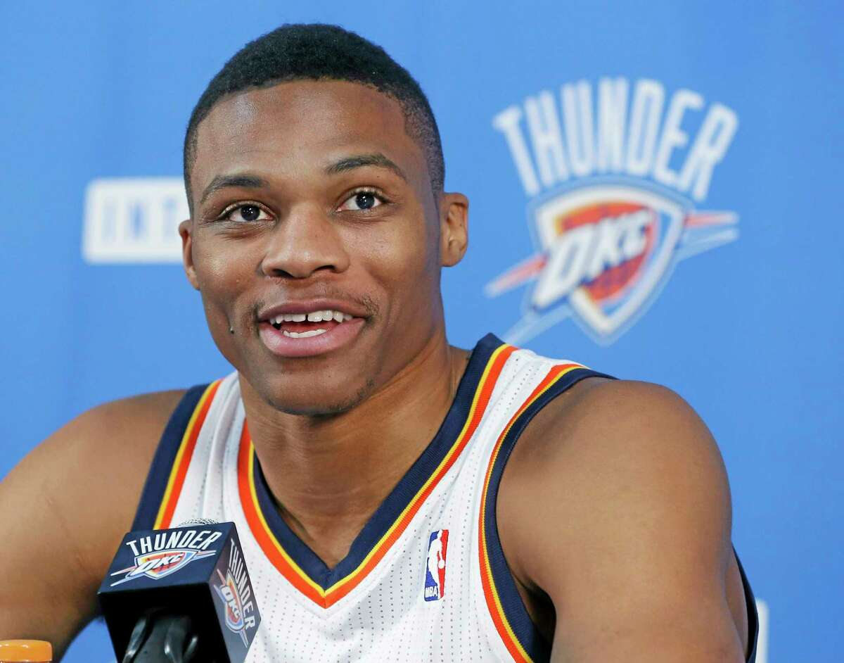 Oklahoma City Thunder guard Russell Westbrook smiles as he answers a question during a news conference during media day on Friday in Oklahoma City.