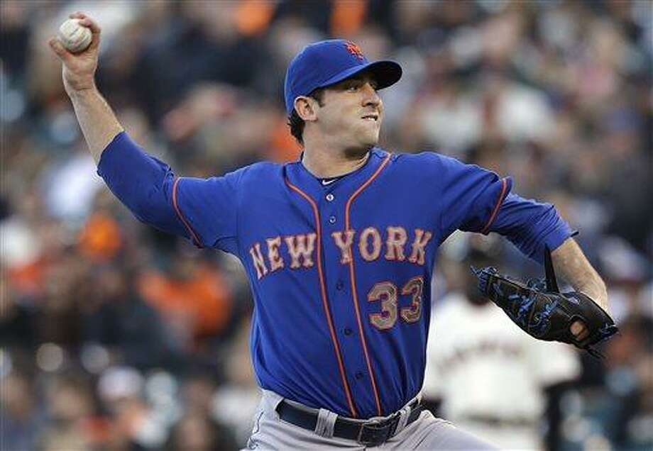 New York Mets pitcher Matt Harvey (33) throws against the San Francisco Giants during the first inning of a baseball game in San Francisco, Monday, July 8, 2013. (AP Photo/Jeff Chiu) Photo: AP / AP