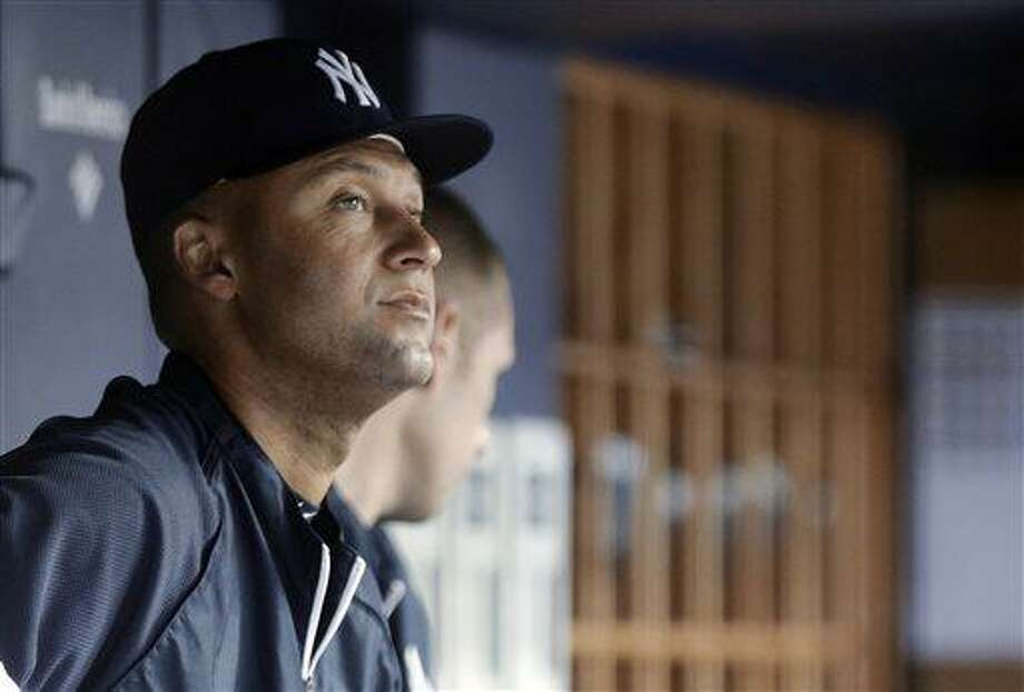New York Yankees' Derek Jeter watches from the dugout during the second inning of the Yankees' baseball game against the Minnesota Twins on Friday, July 12, 2013, in New York. (AP Photo/Frank Franklin II) Photo: AP / AP