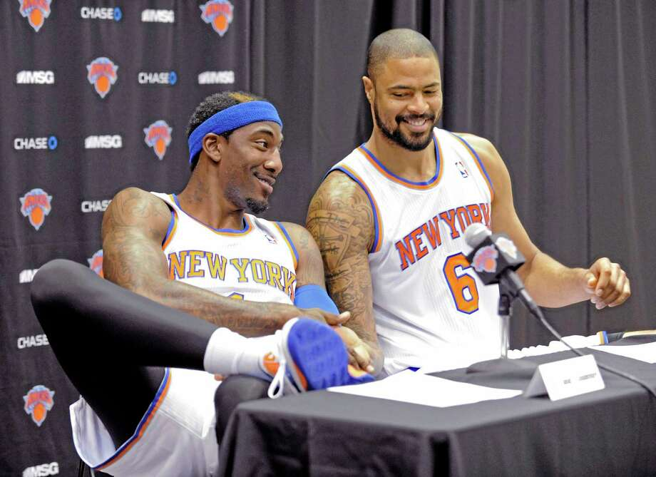 The New York Knicks' Amar'e Stoudemire, left, shakes hands with teammate Tyson Chandler at media day on Monday in Greenburgh, N.Y. Photo: Bill Kostroun -- The Associated Press  / FR51951 AP