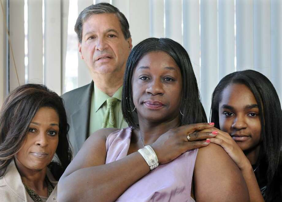 Attorneys Sandy Brown of New London left and Rick Altschuler of West Haven with their client Ola Hardy second from right with her daughter Jada Kinsey age 14 right in Altschuler's office. Hardy's son Chauncey was killed in Romania after being beaten at a bar. At the time, Hardy was playing basketball professionally in Romania. Mara Lavitt/New Haven Register