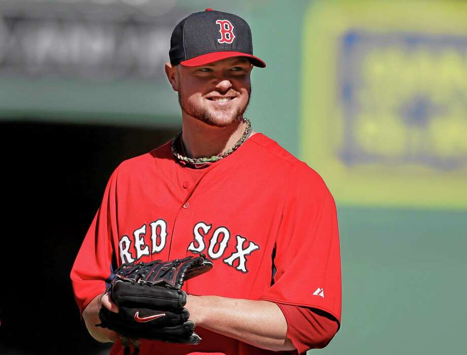 Red Sox pitcher Jon Lester smiles during a team workout on Tuesday at Fenway Park in Boston. The Red Sox host Game 1 of the AL divisional series on Friday against the winner of Wednesday's wild-card game between the Cleveland Indians and Tampa Ray Rays. Photo: Steven Senne -- The Associated Press  / AP