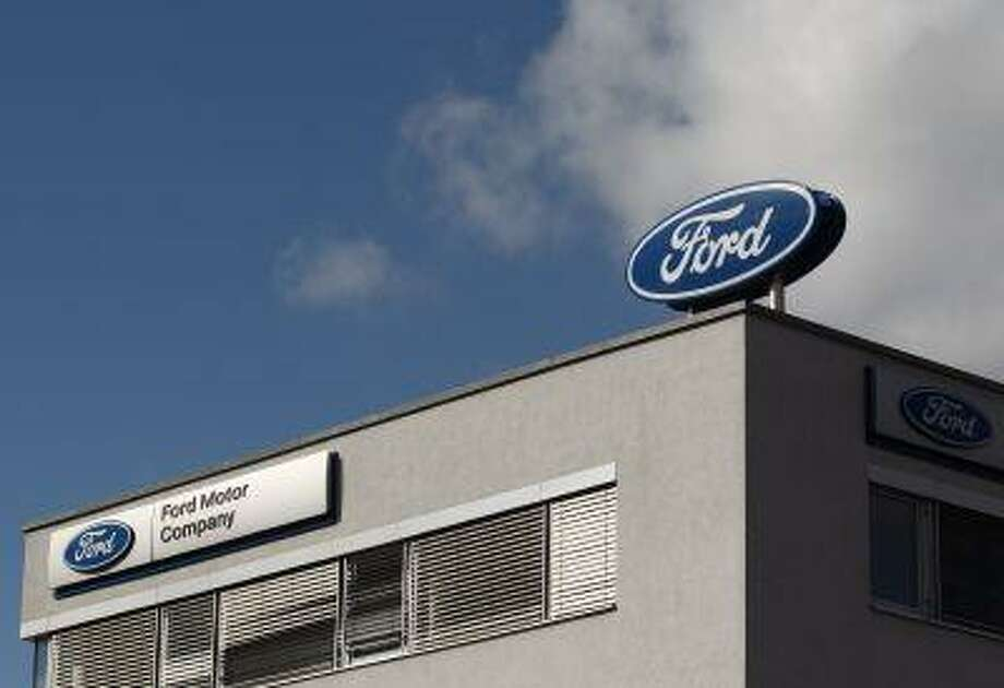 The Ford logo is pictured on the rooftop of Austria's Ford head branch in Vienna March 19, 2013. (REUTERS/Heinz-Peter Bader) Photo: REUTERS / X00316