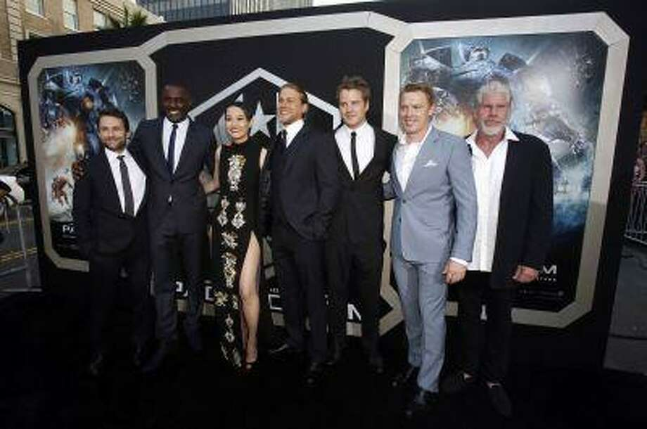 "Cast members (L-R) Charlie Day, Idris Elba, Rinko Kikuchi, Charlie Hunnam, Robert Kazinsky, Diego Klattenhoff and Ron Perlman pose at the premiere of ""Pacific Rim"" at Dolby theatre in Hollywood, California July 9, 2013. (REUTERS/Mario Anzuoni) Photo: REUTERS / X90045"
