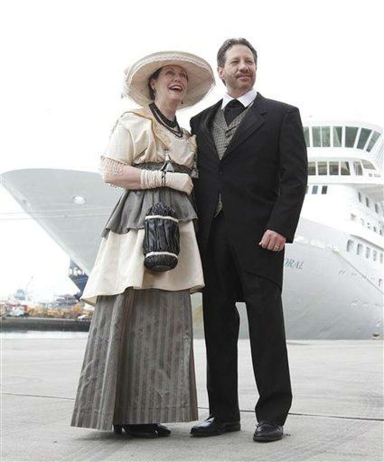 Mary Beth Crocker Dearing and her husband Tom Dearing from Newport, Ky., pose for the media in period costume as they wait to board the MS Balmoral cruise ship in Southampton, England, Sunday. Associated Press Photo: AP / AP