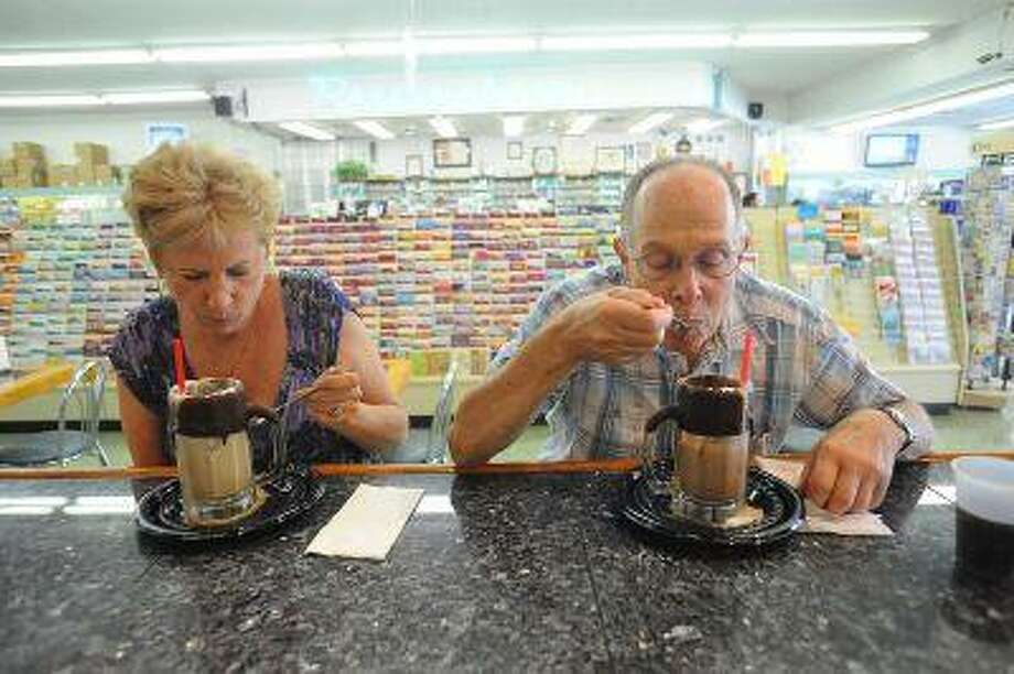 Marsha Wiedder and Mayer Alson enjoy ice cream soda's at Jerry's Soda Shoppe in Canoga Park, CA July 3, 2013. The soda shop is located inside DeSoto Pharmacy and is featured in the July issue of Food Network Magazine.(Andy Holzman/Los Angeles Daily News) Photo: Andy Holzman/Staff Photographer / Los Angeles Daily News