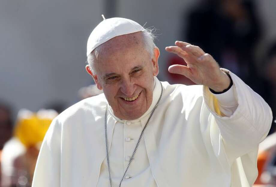 FILE - In this Sept. 18, 2013 file photo, Pope Francis waves to faithful as he arrives for his weekly general audience in St. Peter's Square at the Vatican. Pope Francis convenes his parallel cabinet on Tuesday, Oct. 1, 2013, for a first round of talks on reforming the Catholic Church, bringing eight cardinals from around the globe together in a novel initiative to get local church leaders involved in helping make decisions for the 1.2-billion strong universal Catholic Church. (AP... Photo: AP / AP