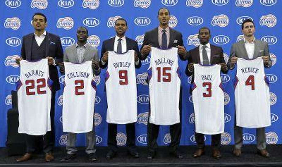 Los Angeles Clippers' Matt Barnes, Darren Collison, Jared Dudley, Ryan Hollins, Chris Paul and J.J. Redick holds jerseys as the Clippers announce updates and additions to their NBA basketball roster, at their headquarters in Los Angeles on Wednesday, July 10, 2013. Photo: ASSOCIATED PRESS / AP2013