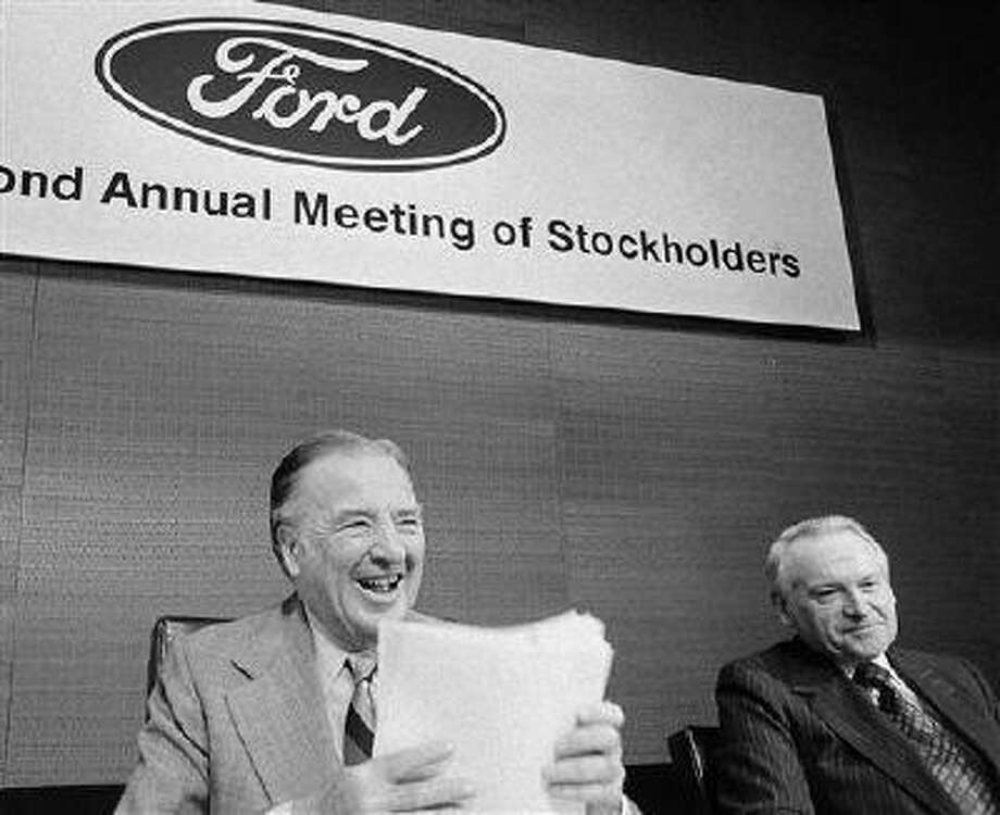 FILE - In a May 12, 1977 file photo, Ford Chairman of the Board Henry Ford II, center, shuffles papers before calling the Ford Motor Company's annual stockholders meeting to order in Detroit. At Ford's left is Philip Caldwell, vice chairman of the board. Cauldwell, the first person to lead Ford Motor Co. who wasn't a member of the founding family, died Wednesday, July 10, 2013 at his home in New Canaan, Conn., at the age of 93. (AP Photo/Richard Sheinwald, File) Photo: AP / AP