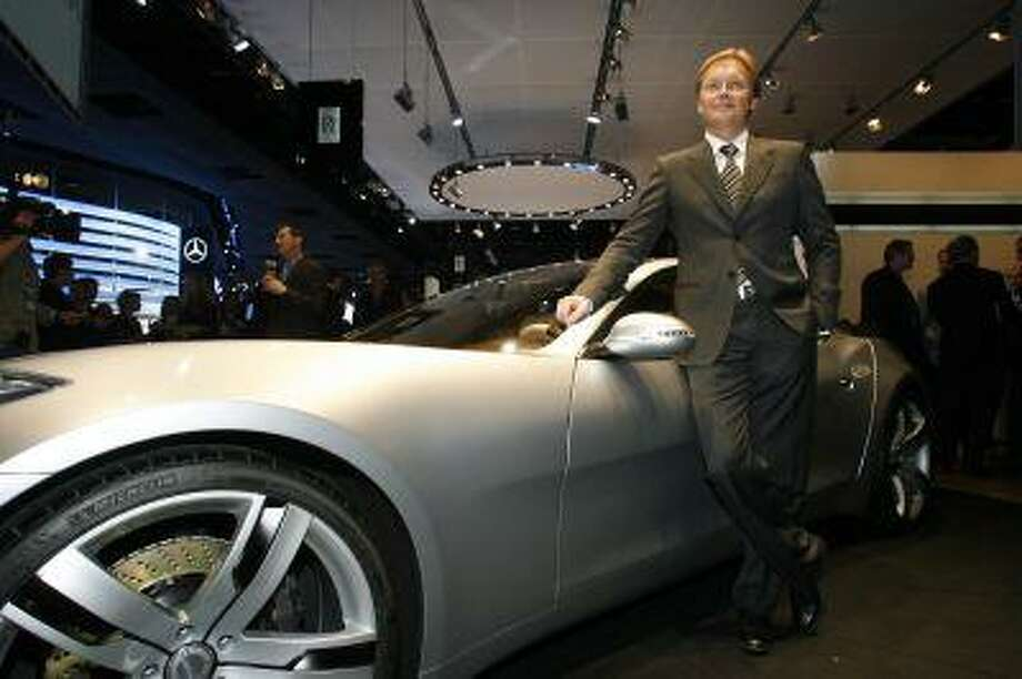 Henrik Fisker, owner of Fisker Automotive, poses next to a Karma at the North American International Auto Show Monday, Jan. 14, 2008 in Detroit. (AP Photo/Gary Malerba) Photo: ASSOCIATED PRESS / AP2008