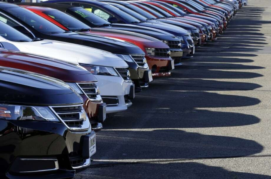 In this Wednesday, Sept. 18, 2013 photo Chevrolet passenger cars form a row on a dealer's lot in Needham, Mass. U.S. auto sales for September are released on Tuesday, Oct. 1, 2013. (AP Photo/Steven Senne_ Photo: AP / AP