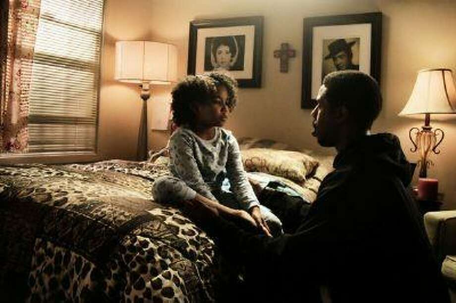 Michael B. Jordan who plays Oscar Grant in the movie, Fruitvale Station, talks with his daughter played by Ariana Neal. The film depicts the final hours in Oscar Grant's life before he was shot and killed by BART police officer Johannes Mehserle on New Year's Day 2009. (Courtesy of The Weinstein Company) Photo: The Weinstein Company / © 2013 THE WEINSTEIN COMPANY. ALL RIGHTS RESERVED.