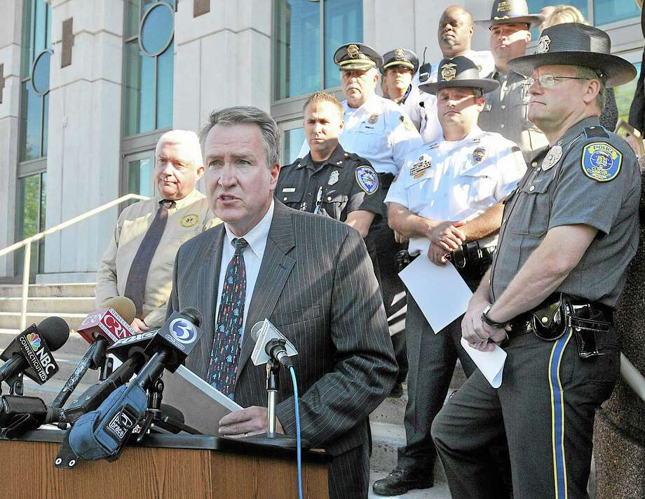 """When law enforcement works together, great things happen,"" said Middlesex County state's attorney Peter McShane at a press conference held at the entrance to Middlesex Superior Court on Court Street in Middletown Monday afternoon. As part of ""Operation Archangel"" officers from multiple Middlesex County police departments worked with agencies including the Connecticut and U.S. Marshals Service, the Department of Homeland Security and the Division of Immigration and Customs Enforcement to arrest nearly 60 individuals early Monday morning. Catherine Avalone - The Middletown Press Photo: Journal Register Co. / TheMiddletownPress"