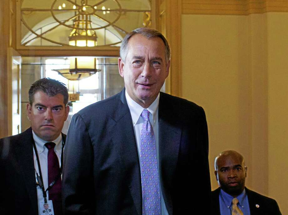 House Speaker John Boehner of Ohio, arrives at the U.S. Capitol in Washington, Saturday, Sept. 28, 2013. Heat is building on balkanized Republicans, who are convening the House this weekend in hopes of preventing a government shutdown but remain under tea party pressure to battle on and use a must-do funding bill to derail all or part of President Barack Obama's health care law. (AP Photo/Molly Riley) Photo: AP / FR170882 AP