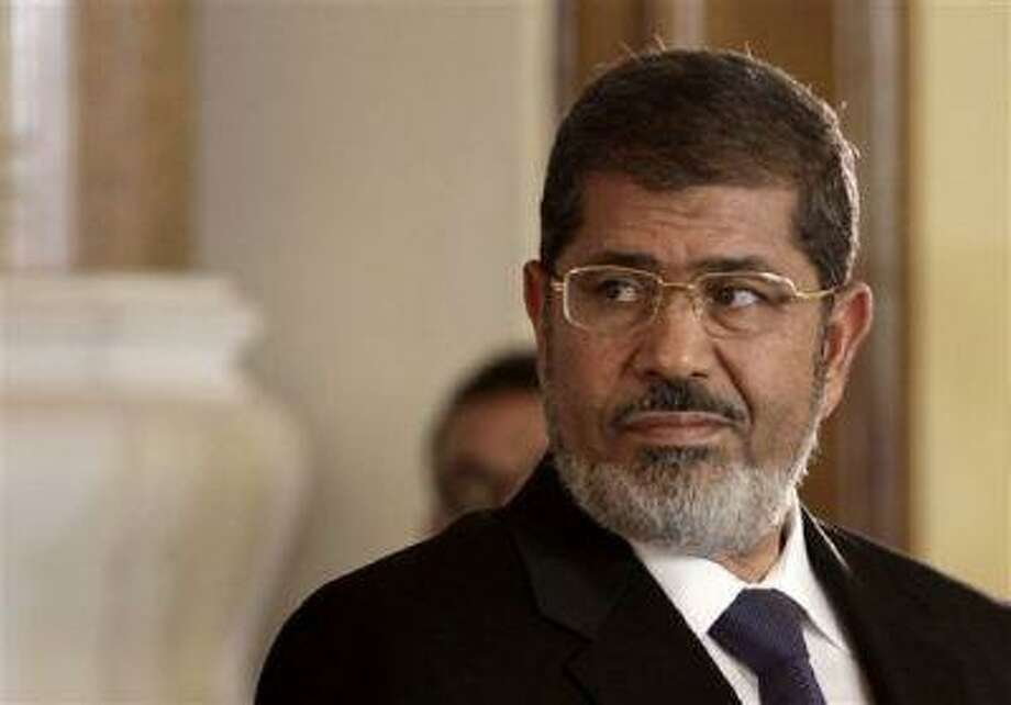 In this Friday, July 13, 2012 file photo, Egyptian President Mohammed Morsi holds a joint news conference with Tunisian President Moncef Marzouki, unseen, at the Presidential palace in Cairo, Egypt.